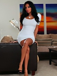 Anissa Kate models her tight white dress then strips..