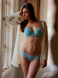 Amber Sym takes off her teal brassiere