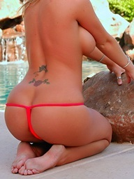 Busty Christine Vinson strips at the pool and shows..