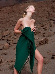 Cute blonde Leslie receives bare on the red sand with..
