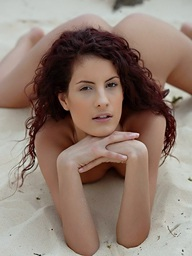 Unshaved redhead Leanna posing bare on the sand by..