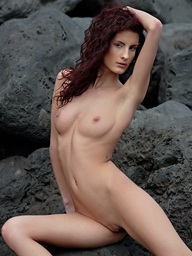 Skiny sweetheart with lengthy legs posing bare on the..