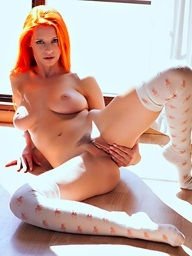A redhead girl exposes her breathtaking body