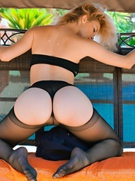 Hotty in dark nylons posing stripped